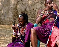 Once proud Masai warriors sitting idle on sandstone rocks, using cell towers to text, nature ignored, a digitally cultivated state of mindless mind, not present, not life, but rather an illusion of what it means to exist.